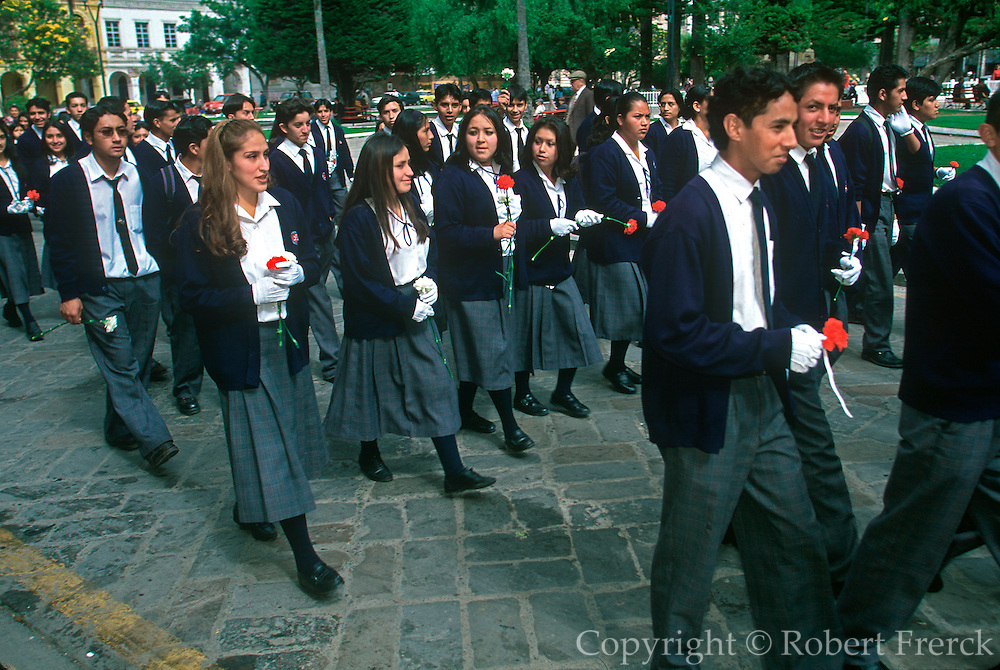 ECUADOR, HIGHLANDS, CUENCA students in procession to Cathedral