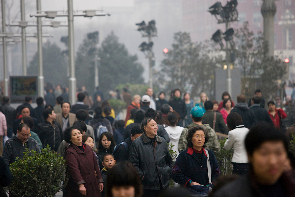 Crowded street corner of Chang An Avenue and Wangfujing Street in Beijing, China