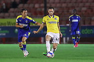 Brighton and Hove Albion midfielder Andrew Crofts (48) battles with AFC Wimbledon midfielder Ethan Chislett (11) during the EFL Trophy Southern Group G match between AFC Wimbledon and Brighton and Hove Albion U21 at The People's Pension Stadium, Crawley, England on 22 September 2020.