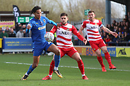AFC Wimbledon defender Toby Sibbick (20) battles for possession in the box during the EFL Sky Bet League 1 match between AFC Wimbledon and Doncaster Rovers at the Cherry Red Records Stadium, Kingston, England on 9 March 2019.