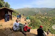People waiting outside cave, Cueva de la Pileta, near Ronda, Malaga province, southern Spain