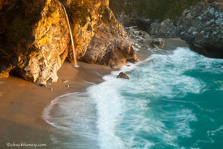 Scenic McWay Falls tumbles into the beach and the Pacific Ocean at Julia Pfeiffer Burns State Park near Big Sur California