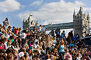 Audience for the kids' Choir is an inspirational music education project developed and run by the Mayor's Thames Festival. Over a seven-month period, the festival works with music teachers and children from primary schools all over London to develop a mass choir of 750 voices. This choir then performs in front of Tower Bridge to thousands of people