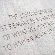 """An inscription that reads """"The lessons learned must remain as a grave reminder of what we must not allow to happen again to any group"""", a quote from former US Congressman and US Senator Danial Inouye, at the Memorial to Japanese-American Patriotism in World War II near the US Capitol in Washington DC. The memorial was designed by Davis Buckley and Nina Akamu and commemorates those held in Japanese American internment camps during World War II."""