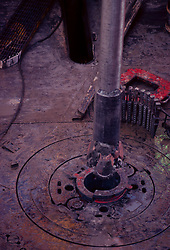 Stock photo of an offshore drilling rig rotary table on drill floor.