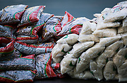 Bags of rice and beans are piled along tables during a pop up grocery event at Powderhorn Park in Minneapolis, Minnesota, U.S., on Friday, July 24, 2020. Photographer: Ben Brewer/Bloomberg