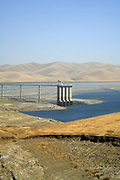 "The San Luis Dam and San Luis Reservoir is a water-storage ""off-stream"" reservoir and is typically low in late summer due to its heavy usage for irrigation, Merced County, California, USA"