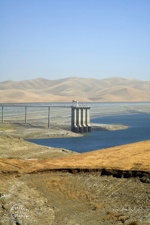 """The San Luis Dam and San Luis Reservoir is a water-storage """"off-stream"""" reservoir and is typically low in late summer due to its heavy usage for irrigation, Merced County, California, USA"""