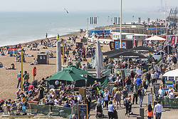 April 18, 2018 - Brighton, East Sussex, United Kingdom - Brighton, UK. Members of the public take to the beach in Brighton and Hove as sunny and warmer weather continues to hit the seaside resort. (Credit Image: © Hugo Michiels/London News Pictures via ZUMA Wire)