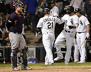 CHICAGO - SEPTEMBER 25:  Welington Castillo #21 celebrates with Yoan Moncada #10 of the Chicago White Sox after Castillo hit a grand slam home run against the Cleveland Indians on September 25, 2019 at Guaranteed Rate Field in Chicago, Illinois.  (Photo by Ron Vesely)  Subject:   Welington Castillo; Yoan Moncada