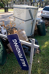 06 Oct, 2005.  New Orleans, Louisiana. Hurricane Katrina aftermath.<br /> Refrigerator line the sidewalks and streets of Uptown neighbourhoods as residents return and throw away the fetid, stinking appliances. Many are taped shut to prevent them from opening. Someone has written, 'Voodoo here today now 5,' on many of the appliances.<br /> Photo; ©Charlie Varley/varleypix.com