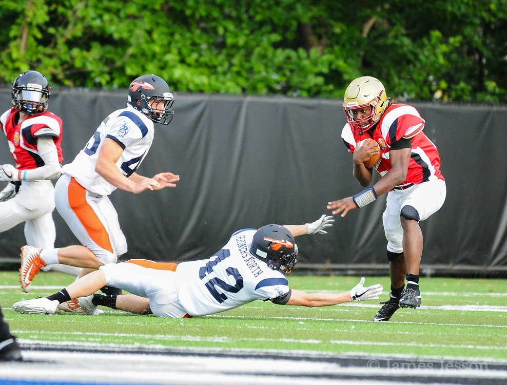 North Squad's Benjamin Robinson, from Wayland High School, tries to take down South Squad's Daniel Abraham, from Boston College High School, during the Shriner's All-Star Football Classic at Bentley University in Waltham, June 22, 2018.   [Wicked Local Photo/James Jesson]