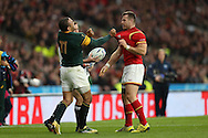Gareth Davies of Wales and Bryan Habana of South Africa clash during the second half  after Wales are awarded a penalty kick. Rugby World Cup 2015 quarter final match, South Africa v Wales at Twickenham Stadium in London, England  on Saturday 17th October 2015.<br /> pic by  John Patrick Fletcher, Andrew Orchard sports photography.