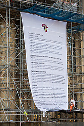 Activists from the group Action for Climate Truth and Reparations (ACTR) hang an open letter to the UK people from Africans Rising For Justice, Peace and Dignity from the Houses of Parliament on 12 November 2020 in London, United Kingdom. The letter, which launches Africans Rising's ReRight History campaign, contains a plea to the UK people to start making amends for the harm caused by slavery and colonialism.