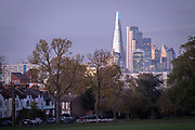 The Shard on the distant Southbank and skyscrapers in the City of London's financial district are seen from Ruskin Park in south London, on 4th November 2020, in London, England.