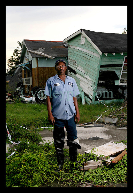 27 August 2006 - New Orleans - Louisiana. Edward Claiborne, (51yrs.) Lower 9th ward. Edward stands in the neighbourhood he grew up in, close to where his mother's house was destroyed by hurricanme Katrina, the area from which he lost friends to the storm. His father 'died of grief' a few months after the storm, Edward says, once his father saw his destroyed home. Edward is wortking for the city, attempting to stop the waste of clean water that pours into drains from the hundreds of cracked water mains in the city. He stands in the lower 9th ward close to the Industrial Canal levee breach and his childhood home which no longer stands.