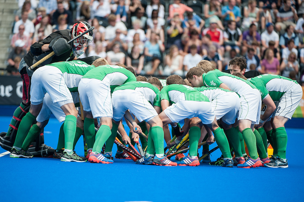 The Irish team huddle before the final of the Investec London Cup against England.  Lee Valley Hockey & Tennis Centre, London, UK on 13 July 2014. Photo: Simon Parker