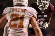 Nov 24, 2011; College Station, TX, USA; Texas A&M Aggies wide receiver Jeff Fuller (8) runs after a catch againstTexas Longhorns safety Blake Gideon (21) during the second half at Kyle Field. Texas won 27-25. Mandatory Credit: Thomas Campbell