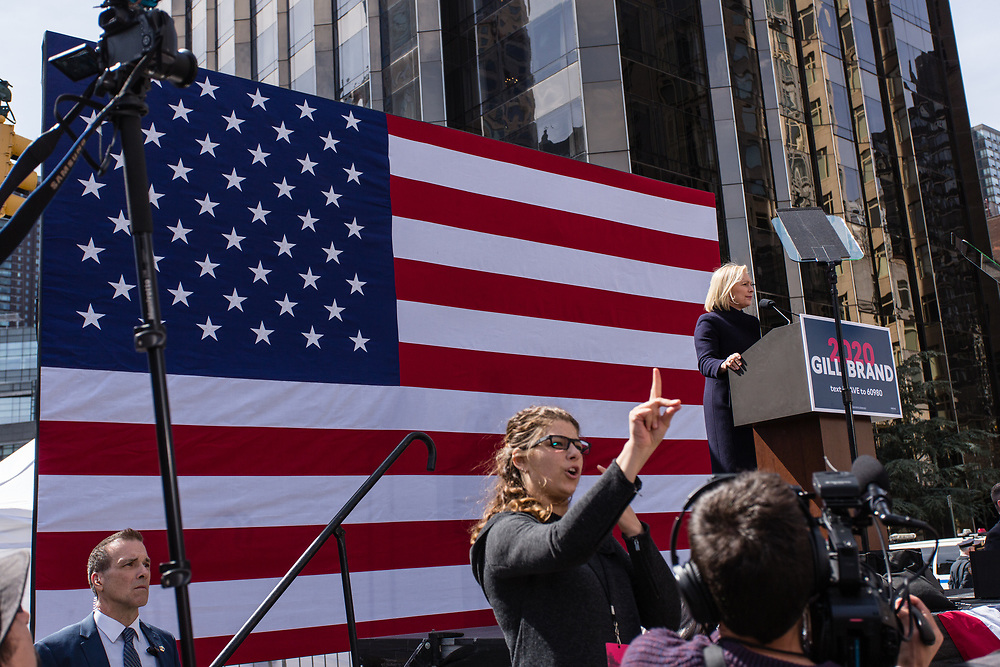 New York, NY - 24 March 2019. Senator Kirsten Gillibrand (D-NY) held a presidential campaign rally on New York's Central Park West in Front of the Trump Hotel  and Tower. A sign language interpreter interprets for Gillibrand.