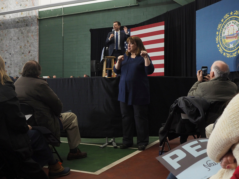 A sign language interpreter translates Democratic presidential candidate Pete Buttigieg address at his Get Out the Vote rally in Milford, New Hampshire.This is his second to last campaign rally prior to the Tuesday, February 11 primary.