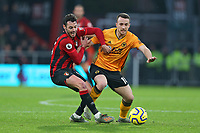 Football - 2019 / 2020 Premier League - AFC Bournemouth vs. Wolverhampton Wanderers<br /> <br /> Bournemouth's Adam Smith gets to grips with Diogo Jota of Wolverhampton Wanderers during the Premier League match at the Vitality Stadium (Dean Court) Bournemouth  <br /> <br /> COLORSPORT/SHAUN BOGGUST