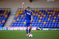 AFC Wimbledon midfielder Jack Rudoni (12) about to take a free kick with hand in the air during the EFL Sky Bet League 1 match between AFC Wimbledon and Hull City at Plough Lane, London, United Kingdom on 27 February 2021.