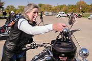 10 OCTOBER 2020 - DES MOINES, IOWA: US Senator JONI ERNST hangs her helmet on her motorcycle's handlebars at a campaign event. Sen. Ernst is on a ride across Iowa. She left Sioux City Saturday morning and stopped in Carroll, IA, before ending the day's ride in Des Moines at Big Barn Harley-Davidson. She had a rally in the parking lot of the Harley-Davidson dealership. The ride is a fundraiser for the Puppy Jake Foundation (which provides service animals to veterans) and the Greater Cedar Rapids Community Foundation's Derecho Disaster Recovery. About 50 people rode with Sen Ernst from Carroll to Des Moines and another 80 were waiting for her in Des Moines.    PHOTO BY JACK KURTZ