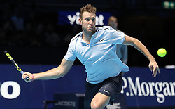 Jack Sock in action against Roger Federer during day one of the NITTO ATP World Tour Finals at the O2 Arena, London.