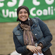 Young woman wearing hijab, at public demonstration<br />
