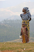 May0016089 . Daily Telegraph..Features..A mother and children in the hills above the town of Cyangugu in south western Rwanda where Rwanda Aid, a british charity and recipient of funds from the Daily Telegraph's 2005 Christmas appeal works to better the lives of the people...Rwanda was the scene of a brutal civil and genocide which ended in 1994 leaving behind 800,000 dead, hundreds of thousands of refugees, many orphans suffering with mental trauma . Still recovering from the civil war the small,landlocked central African state is one of the poorest countries in the world with three quarters of it's 10 million population living below the poverty line and is a huge recipient of foreign aid...Rwanda 28 August 2009