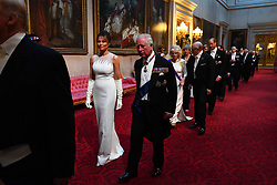 Melania Trump and the Prince of Wales arrive through the East Gallery during the State Banquet at Buckingham Palace, London, on day one of the US President's three day state visit to the UK.