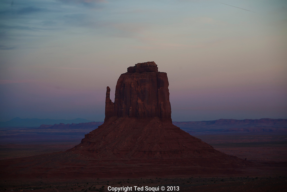 East Mitten butte inside the Monument Valley Tribal Park at sunset. The parked is owned and operated by the Navajo people.