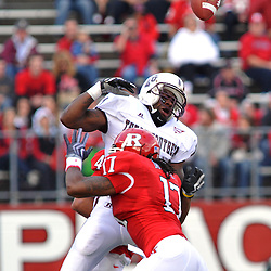 Oct 10, 2009; Piscataway, NJ, USA; Texas Southern wide receiver Joe Anderson (1) drops a pass after being hit by Rutgers linebacker Damaso Munoz (17) during first half NCAA college football action between Rutgers and Texas Southern at Rutgers Stadium.