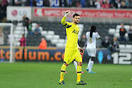 Hugo Lloris, the Tottenham goalkeeper thanks the Spurs fans at the end of the match. Barclays premier league match, Swansea city v Tottenham Hotspur at the Liberty Stadium in Swansea, South Wales on Sunday 4th October 2015.<br /> pic by  Andrew Orchard, Andrew Orchard sports photography.