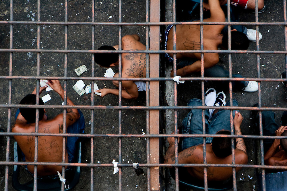 Inmates in two separate sections of  the Cojutepecque prison play cards and gamble outside of San Salvador.  With no chance for rehabilitation  within the prisons, they function as a nexus for Maras to build solidarity and make contacts within their gangs for future illegal activities. For many it is a right of passage into the gang.