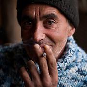 Portrait of a Romania man smoking a cigarette.