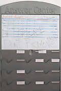 a meeting room board with some half readable notes