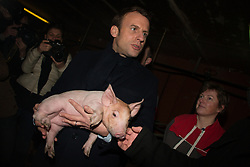 Former French Economy minister, founder and president of the political movement En Marche ! (On the Move!) and candidate in France's 2017 presidential elections, Emmanuel Macron visits a farm as part of his campaign, on January 17, 2017, in Moustoir-Remungol, western France. Photo by Vincent Feuray/ABACAPRESS.COM  | 578483_001 Moustoir-Remungol France