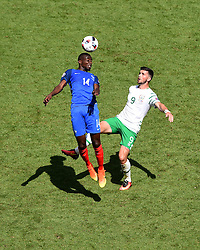 Blaise Matuidi of France battles for the high ball with, Shane Long of Republic of Ireland  - Mandatory by-line: Joe Meredith/JMP - 26/06/2016 - FOOTBALL - Stade de Lyon - Lyon, France - France v Republic of Ireland - UEFA European Championship Round of 16