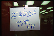 The OJ Simpson trial and media circus.<br /> A sign on the WLA LAPD front door.