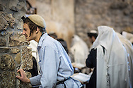 """A Jewish prayer inside the Wilson's Arch """"trembling to fulfill the word of God"""" should be considered a Haredim. Despite the Kotel is an haredi synagogue the definition of Haredi is controversial. A rabbi on the Jerusalem post in 2012 reflects on some of the rules to be a haredi. Among these """"the  person that does not wear black from head to toe is not haredi. A person whose kippa is not black is not haredi. A person who wears a blue shirt is not haredi."""""""
