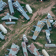 B-52 Stratofortress bombers lay in the Arizona sun, dismantled in accordance with the Strategic Arms Reduction Treaty, at the 309th Aerospace Maintenance and Regeneration Group's Aircraft and Missile Storage and Maintenance Facility on Davis-Monthan AFB, Ariz., Aug 2, 2017. Three hundred sixty-five B-52s were flown to the AMARG in the early 90s and cut into five pieces in accordance with the treaty. (U.S. Force Photo by Staff Sgt. Perry Aston)