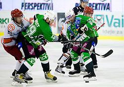 Ales Remar of Acroni Jesenice, Anze Ropret of Olimpija, Ivo Jan of Olimpija at 38th Round of EBEL league  ice hockey match between HDD Tilia Olimpija Ljubljana and HK Acroni Jesenice, on January 1, 2010, in Arena Tivoli, Ljubljana, Slovenia. (Photo by Vid Ponikvar / Sportida)