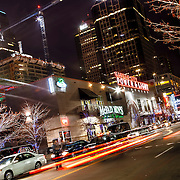 Grand Avenue in downtown Kansas City, Missouri on a Saturday evening, near Sprint Center arena. Progress on One Light Tower residential construction underway in background.