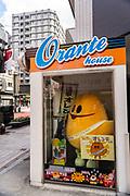 Japanese mascot Orente greets visitors from the Orante House on Orange Street near the Sensoji temple in Asakusa, Tokyo, Japan.