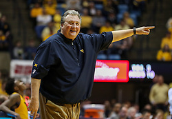 Feb 24, 2018; Morgantown, WV, USA; West Virginia Mountaineers head coach Bob Huggins smiles while arguing a call during the second half against the Iowa State Cyclones at WVU Coliseum. Mandatory Credit: Ben Queen-USA TODAY Sports