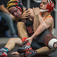 022015       Cable Hoover<br /> <br /> Grants Pirate Braman Merayo grapples with Española Sundevil Julian Martinez during the New Mexico State Wrestling Tournament at the Santa Ana Star Center in Albuquerque Friday.
