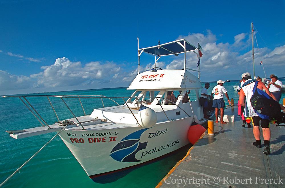 MEXICO, YUCATAN, COZUMEL scuba divers on boat to Palancar Reef