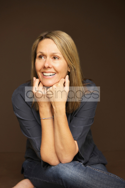 Smiling Woman Leaning on Elbows