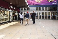 Three teenagers walking in Basildon Town Centre. Essex
